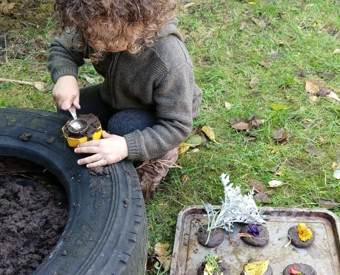 child making mud pies